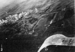 Aircraft of squadron VB-80 from USS Ticonderoga attacking the railroad south of Heito Airfield, southern Taiwan, 9 Jan 1945