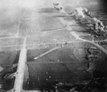 Kagi Airfield under carrier aircraft attack, Taiwan, 12 Oct 1944, photo 5 of 5