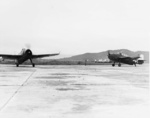 Two TBM-3 aircraft of US Navy squadron VT-26 at Matsuyama Airfield, Taihoku (now Taipei), Taiwan, early Sep 1945