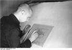 Soviet prisoner of war working on a technical drawing at Peenemünde Army Research Center, Germany, 1940s