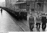 Hitler Youth members on march in a German city, en route to volunteer to join the military, 25 Nov 1944