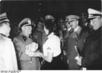 Benito Mussolini receiving flowers from a member of the League of German Girls, Munich, Germany, 30 Sep 1938
