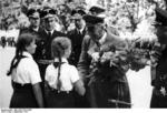 Wilhelm Frick receiving flowers from members of the League of German Girls during a visit to Bratislava, Slovakia, Sep 1941
