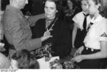 German woman being awarded the Cross of Honor of the German Mother, 17 May 1943; note League of German Girls members present