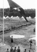 Hitler Youth members gathering on a camp ground for the Nazi Party flag raising, circa 1930s