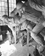 Sculptor Felix de Weldon working on the plaster model of the US Marine Corps War Memorial, circa 1954, photo 1 of 7
