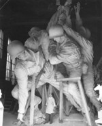 Sculptor Felix de Weldon working on the plaster model of the US Marine Corps War Memorial, circa 1954, photo 5 of 7