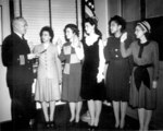 US Navy Cmdr. Thomas Gaylord administering oath to five new nurses commissioned in New York, United States, 8 Mar 1945; Phyllis Mae Dailey, USN