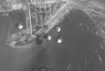 Bombs dropping in Toshien harbor, Takao (now Zuoying harbor, Kaohsiung), Taiwan, 16 Oct 1944