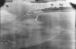 View of Toshien harbor (now Zuoying harbor), Takao (now Kaohsiung), Taiwan, 12 Oct 1944, photo 2 of 2; photo taken by aircraft of USS Enterprise