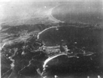Suo (now Suao) harbor under attack by a PB4Y-1 aircraft of US Navy squadron VPB-104, eastern Taiwan, 22 Apr 1945, photo 2 of 4