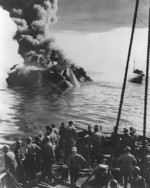 Sinking of oiler USS Mississinewa after being struck by a Kaiten in Ulithi anchorage, Caroline Islands, 20 Nov 1944; photograph taken from fleet ocean tug USS Munsee