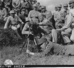 US soldiers instructing Chinese soldiers on the use of a 60-mm mortar at the Kunming Infantry School, Yunnan Province, China, 23 Sep 1944