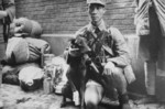 Chinese soldier with a wounded war dog, date unknown