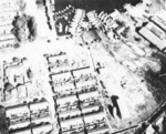 Aerial reconnaissance photo of facilities at Takao naval base, Taiwan, 13 Oct 1944, photo 1 of 2; note barrage balloon