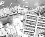 Aerial reconnaissance photo of facilities at Takao naval base, Taiwan, 13 Oct 1944, photo 2 of 2; note barrage balloon