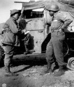War Correspondent Ted Stanford of The Pittsburgh Courier interviewing African-American US Army Sergeant Morris O. Harris of the 784th Tank Battalion of the 9th Army, 28 Mar 1945