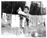 Japanese-American soldier of the 100th Infantry Battalion, 442nd Regiment, US 34th Infantry Division hanging his laundry, Chambois Sector, France, 12 Oct 1944