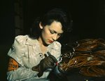 American female aircraft worker working at the Vega Aircraft Corporation, Burbank, California, United States, Jun 1942