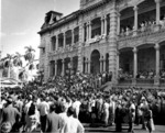 Crowd gathering at the Iolani Palace grounds to welcome returning Japanese-American troops of US 442nd Regimental Combat Team, Honolulu, US Territory of Hawaii, 9 Aug 1946