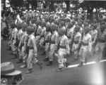 Japanese-American troops of US 442nd Regimental Combat Team marching in the Veterans Day Parade at Kapiolani Park, Honolulu, US Territory of Hawaii, 15 Aug 1946, photo 2 of 2