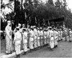 Japanese-American troops of US 442nd Regimental Combat Team presenting company guidon to Hawaii National Guard at deactivation ceremony, Kapiolani Park, Honolulu, US Territory of Hawaii, 15 Aug 1946