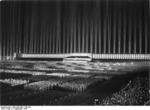 Nazi Party rally at Zeppelinfeld, Nuremberg, Germany, 8 Sep 1936; the structure was designed by Albert Speer