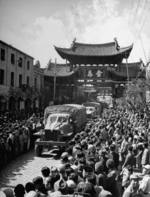 Civilians of Kunming, Yunnan Province, China watching as the first convoy across the Ledo Road arrived, early 1945, photo 2 of 2