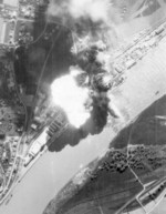 An oil tank explosion at Deggendorf harbor, Bavaria, Germany after an aerial bombardment by A-20 Havoc aircraft of US 426th Bomb Group, 20 Apr 1945