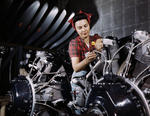 American woman working on an aircraft engine at a North American Aviation plant in California, United States, Jun 1942