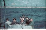 German officers observing the firing of 8.8cm guns from a gunboat on the Black Sea off Constanta, Romania, Jul 1941