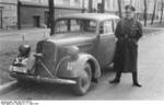 German Sturmführer Zwiebel posing with an official automobile in Riga, Latvia, 7 Mar 1943
