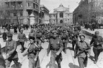 Troops of the Soviet 62nd Stalingrad Army marching in Odessa, Ukraine, Apr 1944; note two female soldiers in foreground