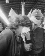 A Russian woman reunited with a soldier returning after the war, 1 Jun 1945