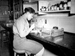 African-American US Army WAC Pfc Johnnie Mae Welton conducting a lab experiment in the serology lab at Fort Jackson Station Hospital, Fort Jackson, South Carolina, United States, 20 Mar 1944