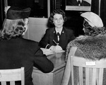 WAVES Ensign May Herrmann recruiting two women at the Officer Procurement office, Philadelphia, Pennsylvania, United States, 30 Oct 1942