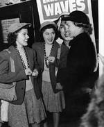 Twin sisters Ann Louise Budnick and Jule Louise Budnick talking with a WAVE personnel, New York City, New York, United States, 8 Feb 1943