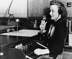 WAVES Specialist (Teacher) Katherine Dillon monitoring a radio range chart, while serving as a Link trainer instructor at Naval Air Station, St. Louis, Missouri, United States, 3 Nov 1943