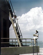 A US Navy Sailor and a WAVES personnel on duty as control tower spotters at Naval Air Station, Norfolk, Virginia, United States, circa 1944-1945