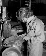 WAVES Aviation Metalsmith 3rd Class Robie Young working at a grinder in the Assembly and Repair Department, Naval Air Station, Seattle, Washington, United States, circa 1943