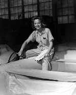 WAVES Aviation Metalsmith 2nd Class Kathryn A. Wolny repairing an inflatable liferaft for use on patrol planes, Naval Air Station Kaneohe, US Territory of Hawaii, 9 Jul 1945