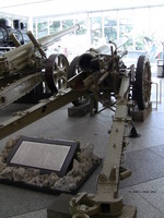 Type 96 15-cm howitzer on display at Yushukan Museum, Tokyo, Japan, 7 Sep 2009, photo 2 of 2; note Type 89 15-cm cannon, A6M Zero Model 52 fighter in background