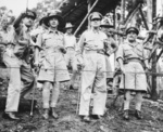 Australian Brigadier Charles Spry pointing out locations of heavy fighting to Australian LtGen Edmund Herring, American Gen Douglas MacArthur, and Australian MajGen Arthur Allen, New Guinea, Oct 1942
