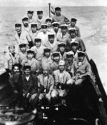 Crew of Japanese submarine I-29 posing with Subhash Chandra Bose off Madagascar, 28 Apr 1943