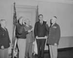 General Dwight Eisenhower swearing General Omar Bradley into office as Chief of Staff of the US Army, Pentagon, Arlington, Virginia, United States, 7 Feb 1948, photo 2 of 3; note US President Harry Truman and Secretary of Army Kenneth Royall in background