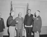 General Dwight Eisenhower swearing General Omar Bradley into office as Chief of Staff of the US Army, Pentagon, Arlington, Virginia, United States, 7 Feb 1948, photo 3 of 3; note US President Harry Truman and Secretary of Army Kenneth Royall in background
