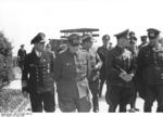 Kranke, Buhle, and Rommel speaking after a weapons demonstration, Northern France, 30 May 1944, photo 1 of 2