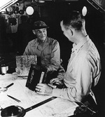 Vice Admiral Mitscher and Commodore Burke aboard carrier Randolph off Okinawa, Japan, 1945, photo 1 of 2
