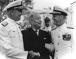 Burke shaking hands of Admiral George W. Anderson, Jr. and Admiral David L. McDonald as the latter relieved the former as Chief of Naval Operations, Washington Navy Yard, DC, United States, 1 Aug 1963