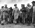 Rear Admiral Burke surrounded by journalists after the Kaesong cease fire talks, Korea, 12 Jul 1951
